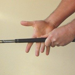 Figure 7. Placing right middle fingers on the club