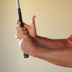 Figure 2. Taking your golf grip - folding right thumb over left.