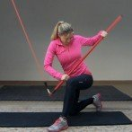 Band Chop (Half Kneeling, Outside Foot Forwards, Dowel) Exercise