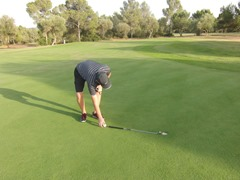 Use a putter to measure 3 feet from hole