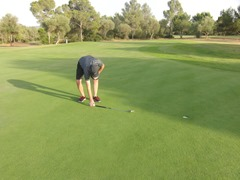 Use a putter to measure 6 feet from hole