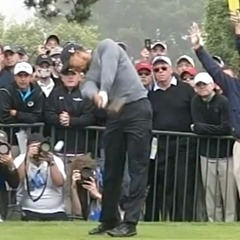 Tiger Woods' follow-through, arms and club extended out towards target
