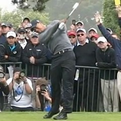 Tiger Woods' follow-through, hands still in front of chest